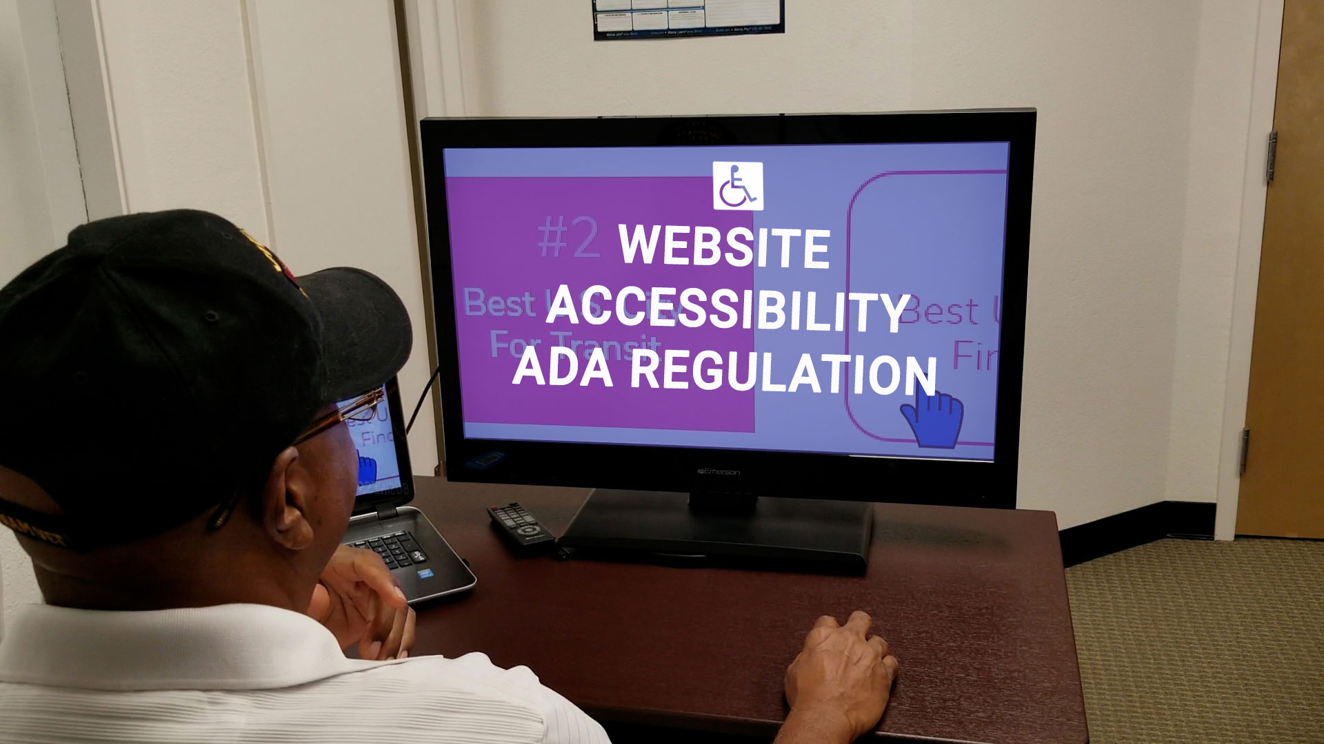 a black man navigating a website using special zoom software for the visually impaired. Text on computer screen says website accessibility ada regulation