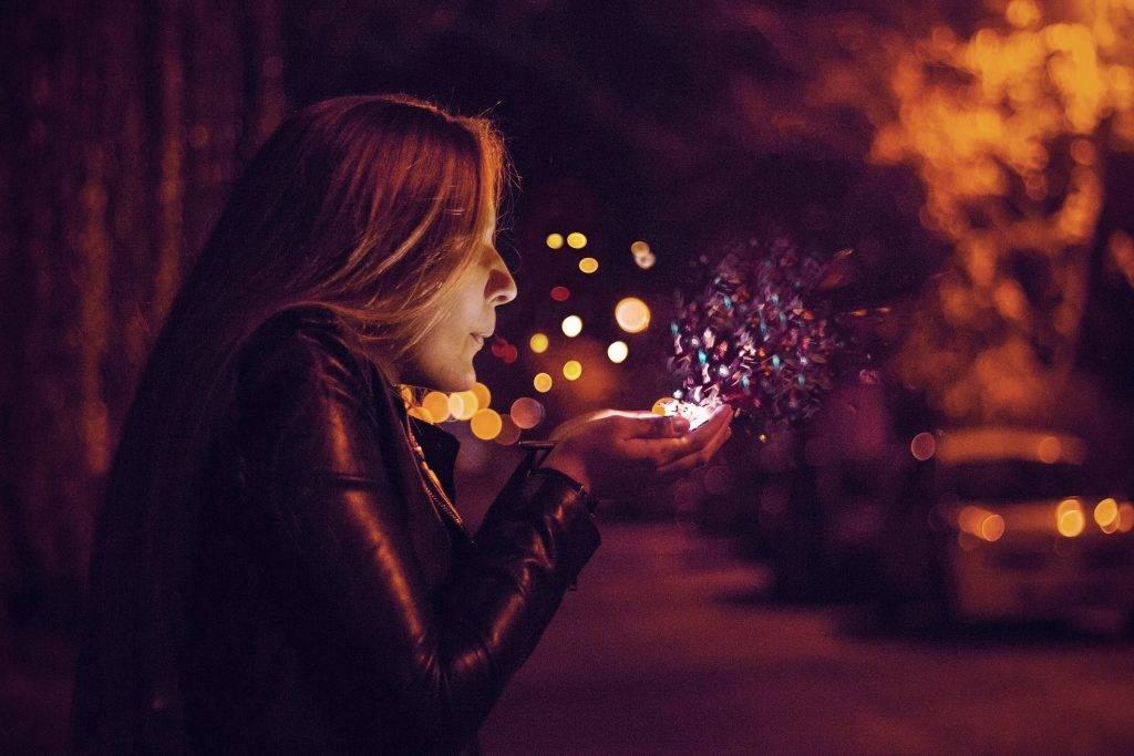 Girl blowing magic dust kisses
